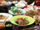 【ご夕食一例・プレミアム会席】山形牛と郷土食豊かな料理が並ぶ、料理長自慢の贅沢コースです。