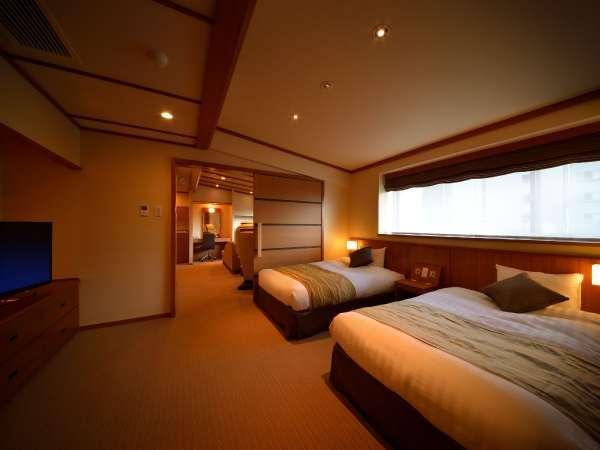 ■ジュニアスイート/セミダブルベッド2台を配置したベッドルームでごゆっくりとお寛ぎください