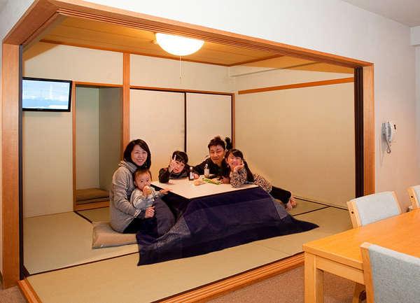 ダイニングテーブルと間仕切りのできる和洋室。冬は暖かいコタツが嬉しい。