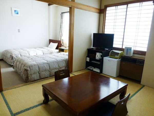 客室ー和洋室タイプ(バス、トイレ付)和室6帖+洋室ツイン