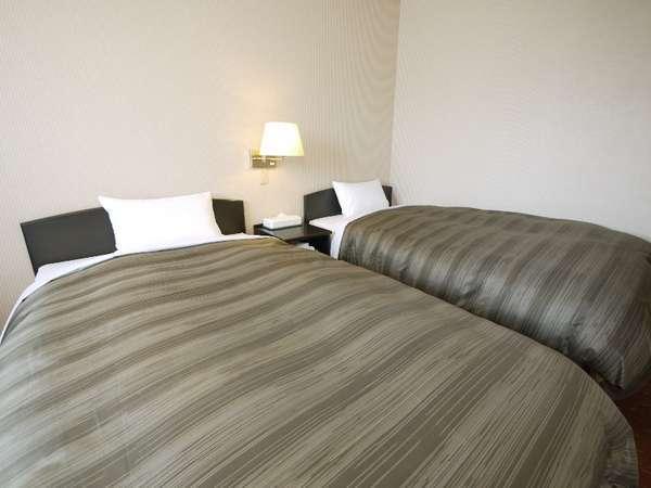 21平米の広々したツインルームです。全室ウォシュレット付です。