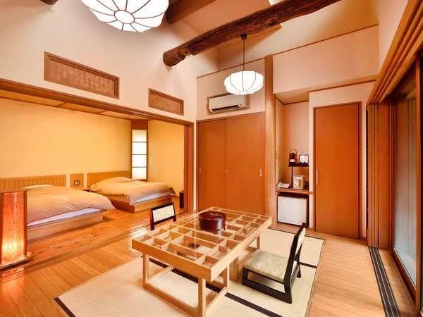 広々とした和洋室。寝室とリビングは扉で仕切れます