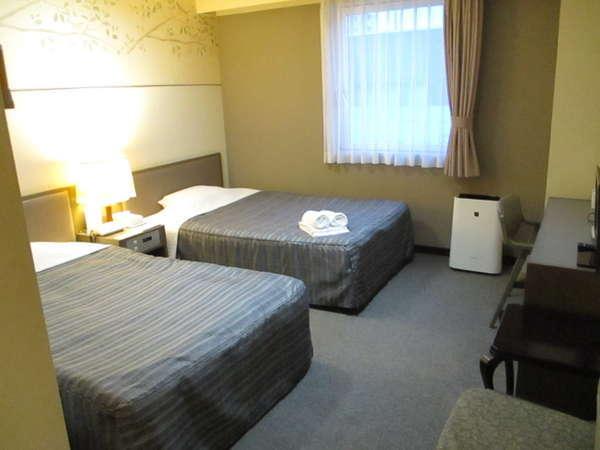 ツインルームの一例。お部屋の広さは20平米で、ベット幅は120×195