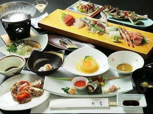 グレードアップ会席の一例。富山の海の幸を楽しみにご来館ください。