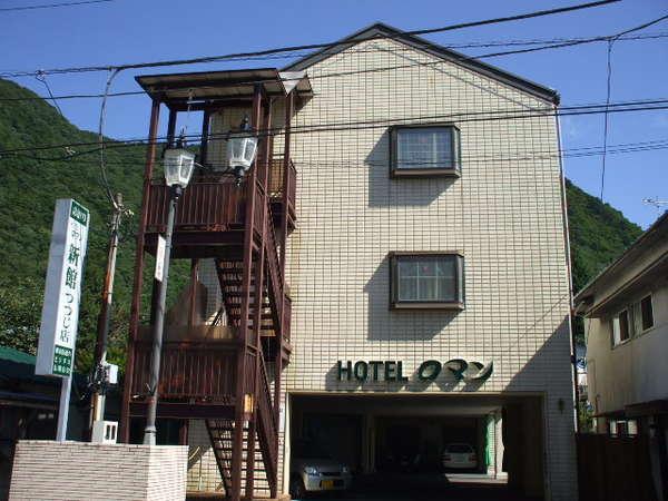 素泊りホテルロマン新館つつじ店の外観