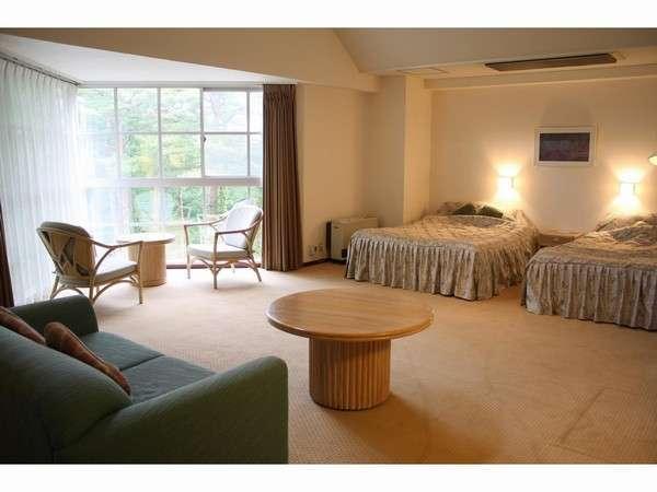 【スポルシオン】ツインルーム例。約55平米の広々とした間取りが人気の客室です