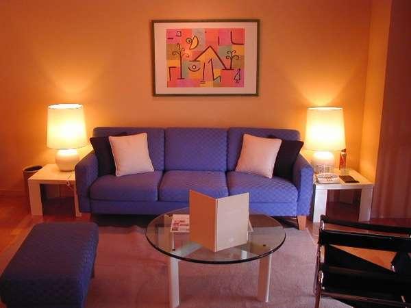 【スポルシオン】DXルーム客室例。洗練された室内は極上のリゾートを演出してくれます