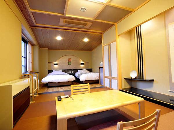 *新客室の和洋室です。ベッドはシモンズ社製で、贅沢な造りとなっております。