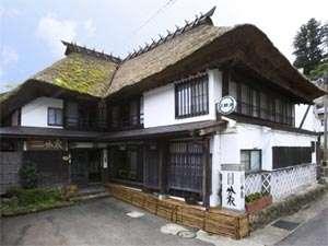 茅葺き屋根に守られた築140年の古民家