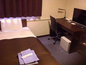 ユニットバスがない分、少し広めのお部屋です。長期滞在のお客様に多く利用いただいています。