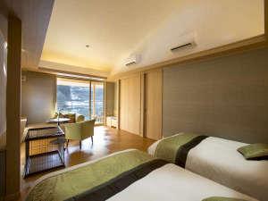 五行のひとつ「木」をイメージした「木(もく)」のお部屋。テーマカラーは緑。