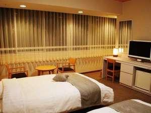 【客室一例】洋室ツインシモンズベットで快適な眠りを・・・。