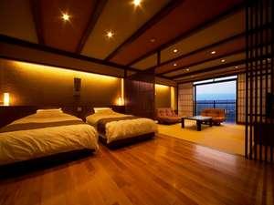 桜の木のフローリングが印象的な「久住」のお部屋。