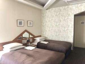 25平米ツインルーム奥には寛ぎスペースも御用意しております。