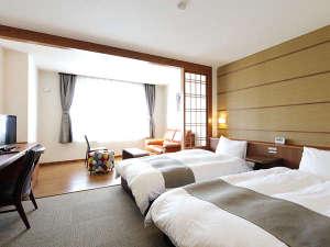 【客室】デラックスツイン<Aタイプ>明るく開放的な空間。2名様でゆったりとお寛ぎ頂けます。