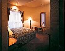 落ち着いた雰囲気で寛げる客室