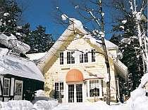 雪景色のハッピーベル外観
