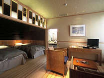 ひのき風呂付洋室一例。段差がほとんどないフラットなフロアが特徴です。