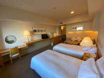 39.4㎡のスタンダードツインルーム。広々としたお部屋は荷物を広げても十分なスペースがあります。