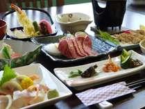 山里料理ー例 黒毛和牛、地鶏の香草焼き、信州サーモン、大岩魚や地元の野菜で作る会席料理です。