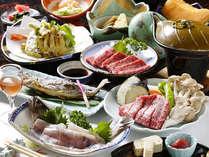 飛騨牛はステーキ付き。その他、岩魚や地元産野菜を使った夕食(一例)