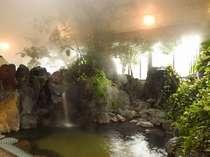 源泉100%。かけ流しの岩風呂。泉質は単純アルカリ泉です