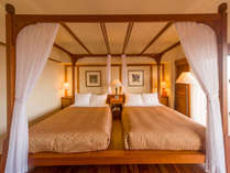 【エグゼクティブツイン】ベッドは天蓋付きのセパレートタイプ。安らぎの眠りをお届け致します。
