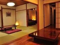 【特別室】10畳のベッドスペース&8畳&置き囲炉裏の和洋室。定員7名。
