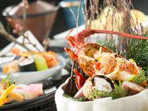 「特別会席」蒸し物:伊勢海老のウニ焼き、濃厚なウニのエキスで食べる、プリプリの伊勢海老が絶品です。
