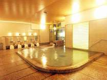 石を基調にした女性用大浴場。広々とした大浴場で旅の疲れを癒して下さいませ。