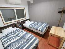 ツインルーム一例:シンプルなつくりの清潔感あるツインルーム