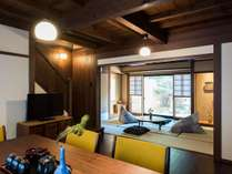 障子から柔らかな光が差し込むリビング。和室と境の襖を開放すると、広い一室としてご利用頂けます。