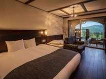 【エコノミーツイン】ダブルベッド+シングルベッドが1台入ったお部屋になります。