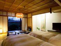 畳のお部屋にツインベッドを入れた和モダンなタイプのお部屋。(写真は一例)