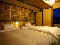 ツインのお部屋には飛騨産業のベッドにシモンズのマットをセット。(写真は一例)