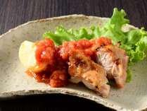 赤城鶏 群馬の希少な高級鶏を、コクと味わい深いトマトソースに絡めた一品。