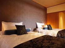 露天風呂付き特別室 『箒星』に設けられたシモンズ製ツインベッド