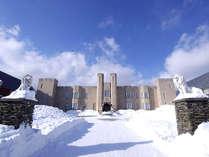 雪に包まれたマナーハウス