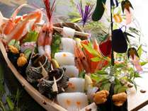 七夕船盛り例です。日本海のイカを天の川に見立てて、海の幸満載に