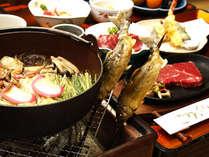 グレードアップコースの料理イメージです。囲炉裏端で郷土料理をご堪能下さい