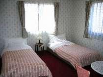 ゆったりとしたベッドルーム