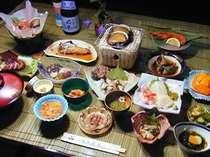 奥尻海の幸フルコース。生ウニ(季節以外はイクラとあわびの丼)やアワビの料理