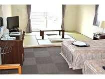 2014リニューアルした和洋室。6条+ツインベッドのお部屋です。