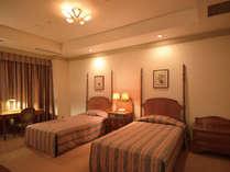 スウィートルームの寝室