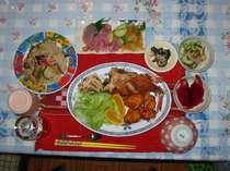 ヨロン島産の新鮮な魚貝類のお刺身、そーめんチャンプルー、ドラゴンフルーツ、ボリュウーム満点の郷土料理