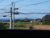 長閑なさとうきび畑と真っ青な海!その向こ23kmに沖縄本島。長閑なお部屋です。