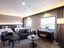 最上階プレミアムツイン 落ち着いた色調の家具で優雅な時間をお過ごしいただけます。