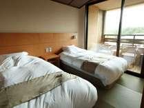 【客室】ゆったりとしたベッドスペースで、安らぎのひと時をお過ごしいただけます。