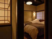 寝室 - 寝具には極上の眠りを誘う日本ベッドを採用