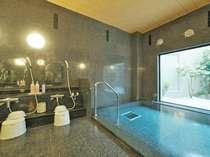 男女別人工ラジウム温泉(画像:男性大浴場)疲労回復・神経痛・肩こり等、各種効能有